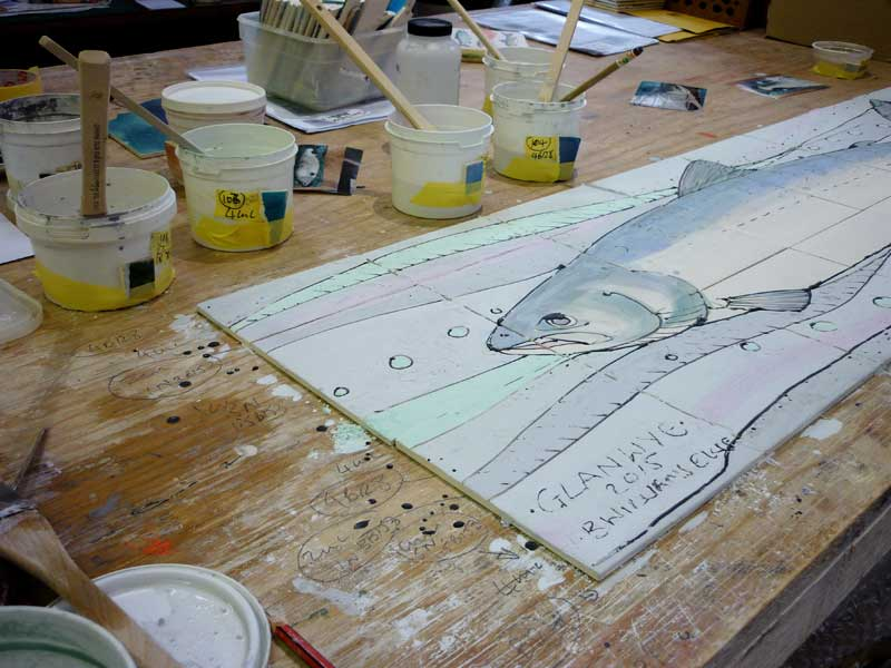 Salmon tile panel being glazed