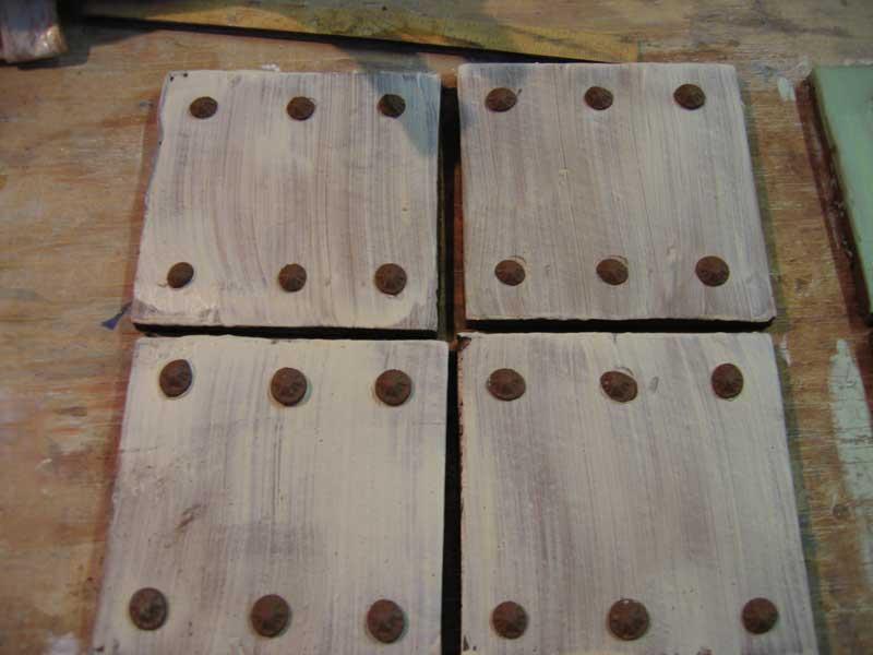handmade clay tiles, rosettes.