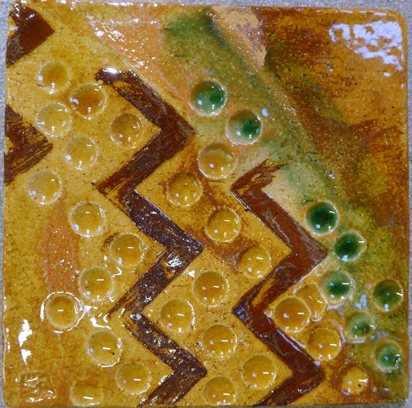 'neolithic' style decorated tile