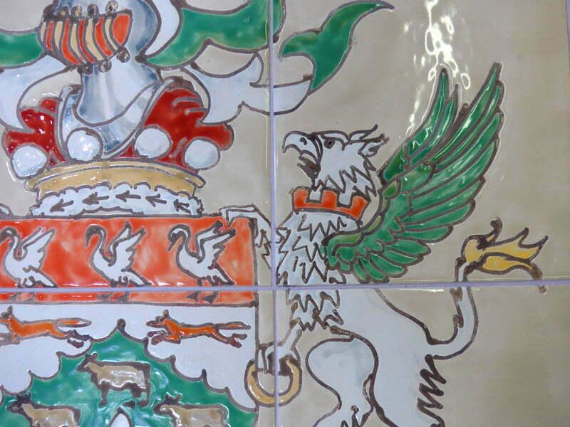 Griffon detail of heraldic crest on tiles..
