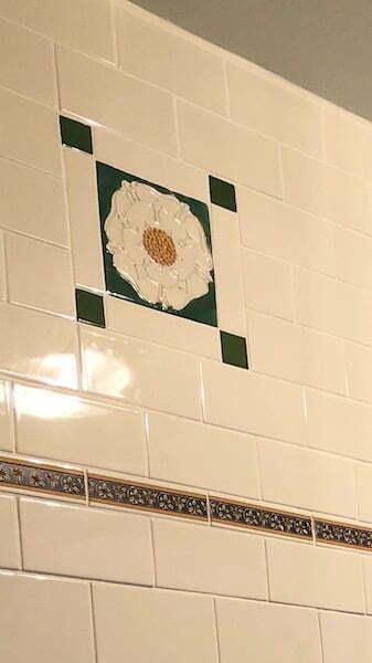 bathroom tube lined roses tiles