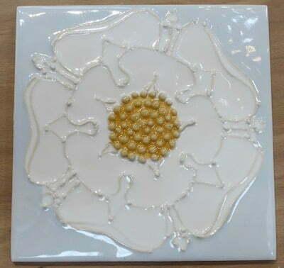 Tubelined white rose on blue
